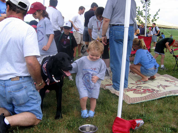 Therapy dogs bring smiles to kids at Family Fun Tent.JPG